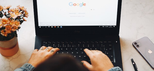 Typing in laptop on Google page
